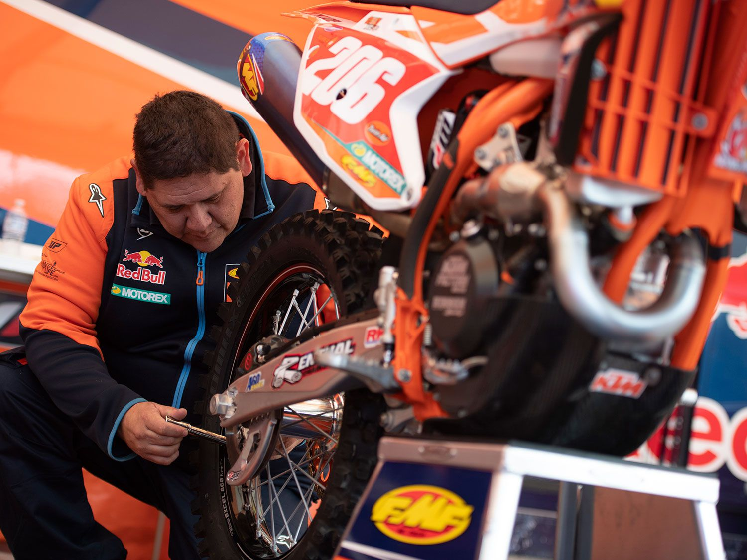 KTM factory mechanic Charles Marchant checks the spokes on Josh Toth's bike before a race.